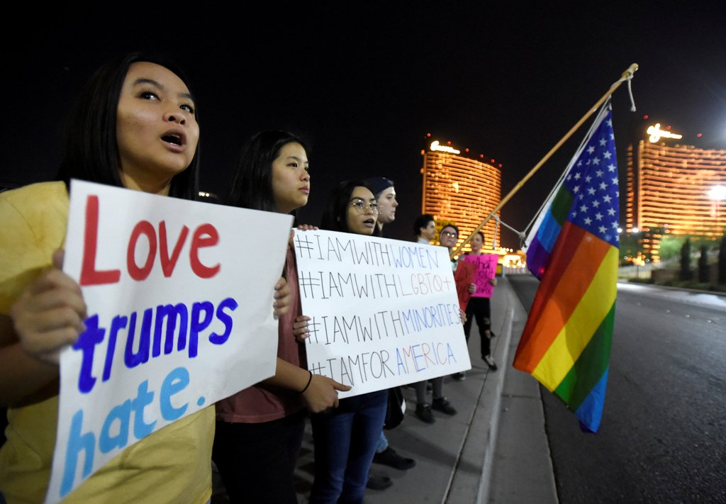 Demonstrators walk through Downtown San Diego in protest to the election of Republican Donald Trump as the president of the United States in San Diego, California