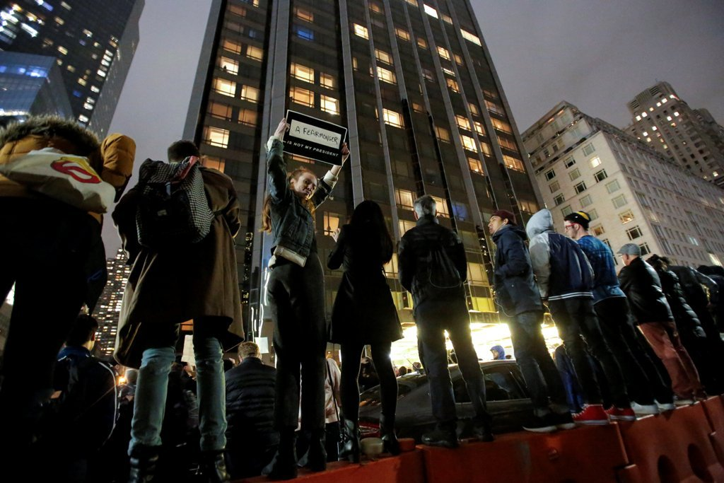 Demonstrators line a fence during a protest outside the Trump International Hotel and Tower following President-elect Donald Trump´s election victory in Manhattan, New York