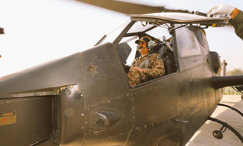 COAS going for an aerial view of offensive manoeuvres onboard a combat attack helicopter.—ISPR photo