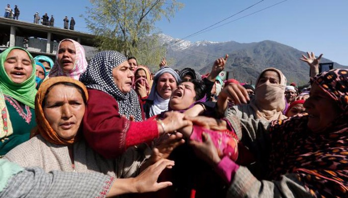 Women wail during the funeral of Umar Farooq, a civilian who was killed on Sunday during a protest against by-polls - Reuters
