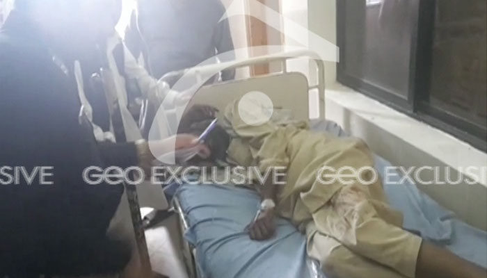 Photo shows man wounded in the attack being treated at the hospital
