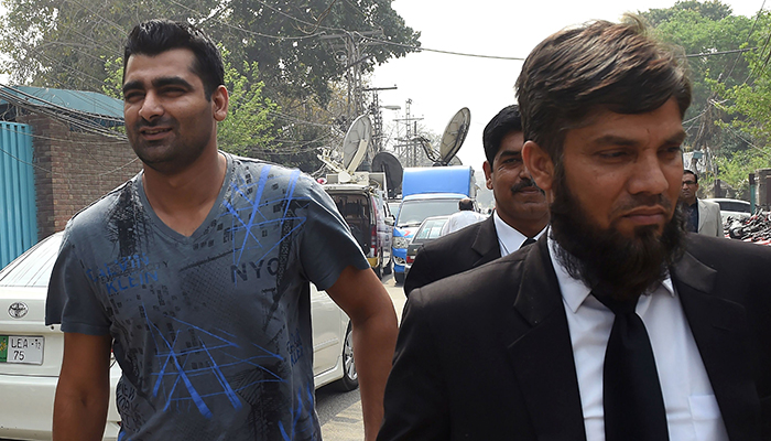 Shahzaib Hasan (L) arrives with his lawyer at FIA  to record his statement in Lahore on March 21, 2017 – AFP