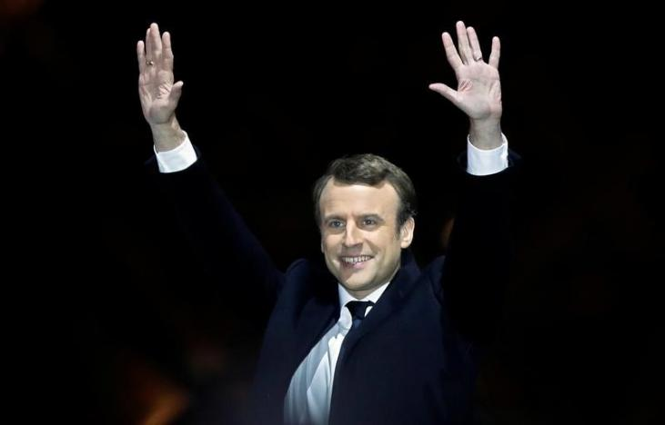 French President-elect Emmanuel Macron celebrates on the stage at his victory rally near the Louvre in Paris - Reuters