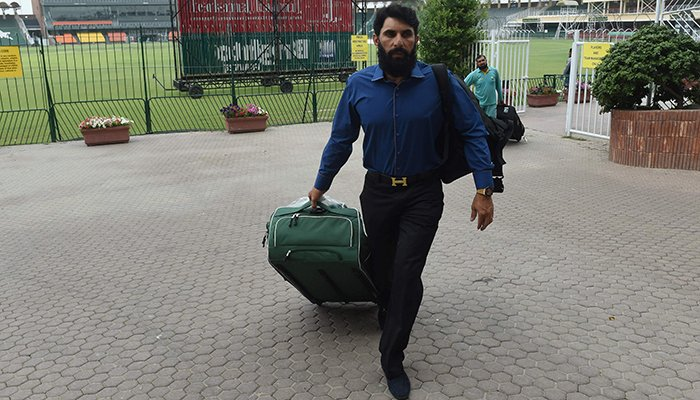 Pakistani Test cricket captain Misbah-ul-Haq leaves after speaking to media at the Gaddafi Cricket Stadium in Lahore - AFP