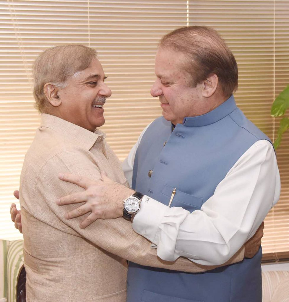 PM Nawaz Sharif embraces his brother Shehbaz Sharif following the SC verdict