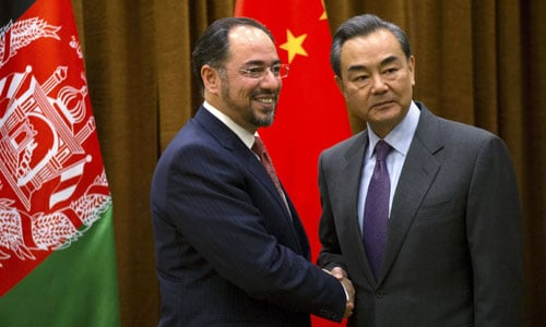 Afghanistan´s Foreign Minister Salahuddin Rabbani, left, shakes hands with Chinese Foreign Minister Wang Yi.—Reuters photo