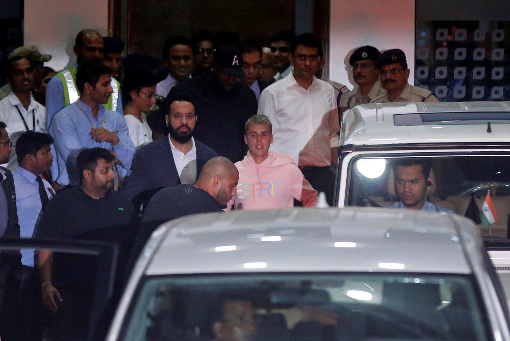 Canadian singer Justin Bieber leaves the airport terminal after arriving in Mumbai, India, May 10, 2017. REUTERS/Shailesh Andrade