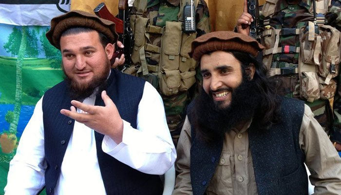 Ehsanullah Ehsan (R) can be seen here with TTP militant commander Adnan Rasheed.—File photo