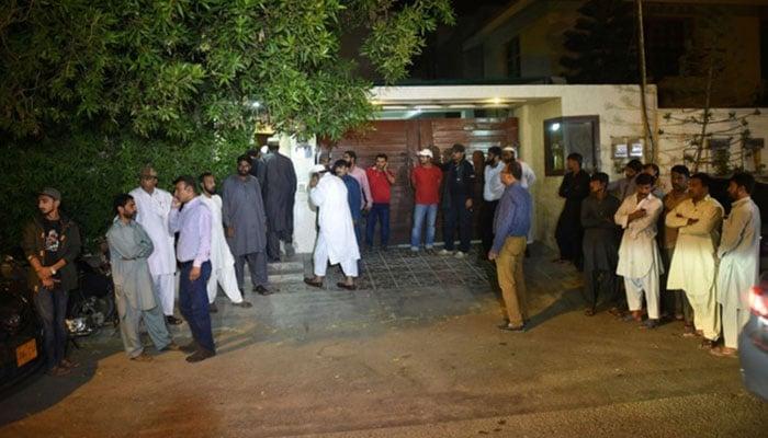 Pakistani people gather outside the house of Junaid Jamshed, a former Pakistani pop star turned evangelical Muslim, in Karachi on December 7, 2016, after his death in plane crash -AFP