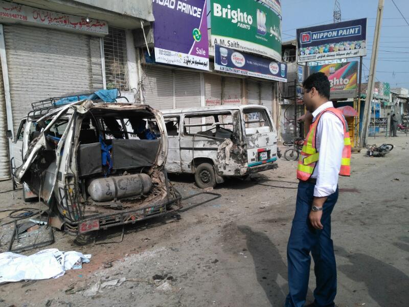 The damaged van at the blast site
