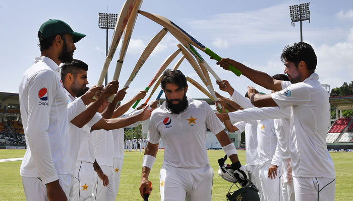 Misbah walks off to a guard of honour after his last innings/AFP