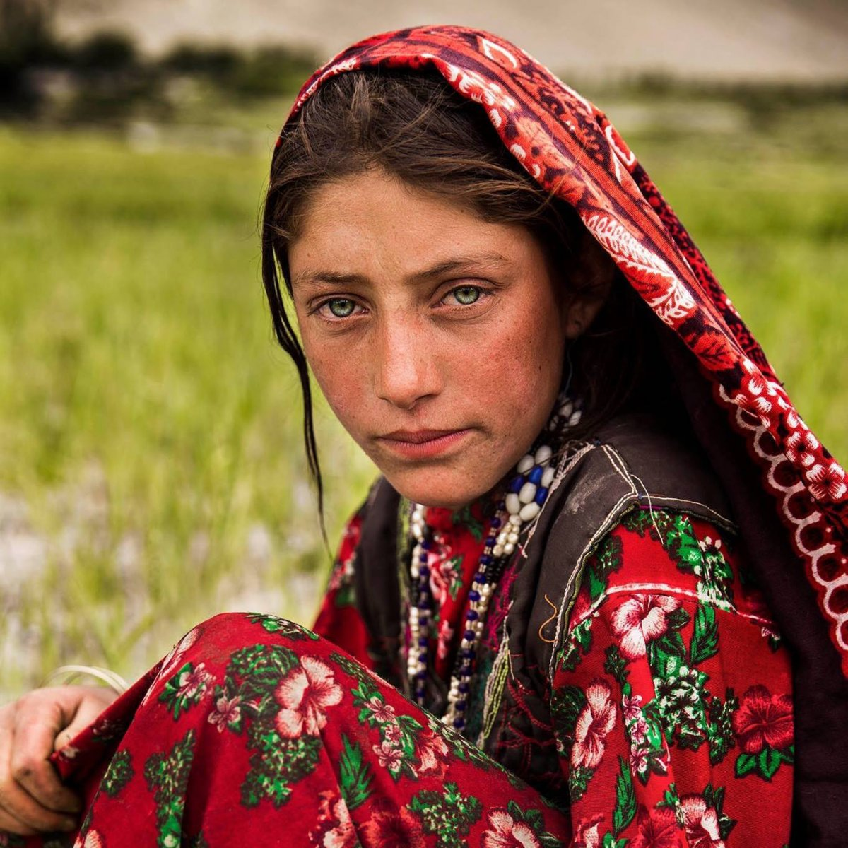 A girl working in the fields of the Wakhan Corridor in Afghanistan photographed by Mihaela Noroc