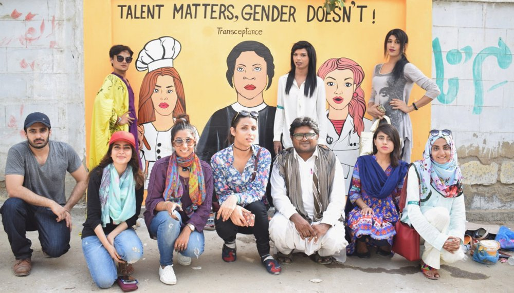 Students and volunteers pose against the mural, while Mohni, Soniya, and Shilpa pose with their respective painted images, Karachi, Pakistan, May 16, 2017