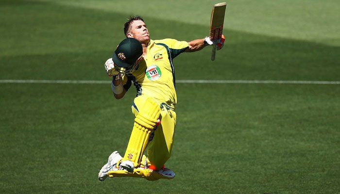 Warner celebrated his century with his trademark leap/Getty Images
