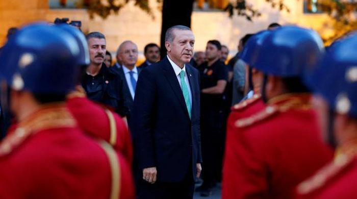 Turkey's Erdogan shuts schools, charities in first state of emergency decree