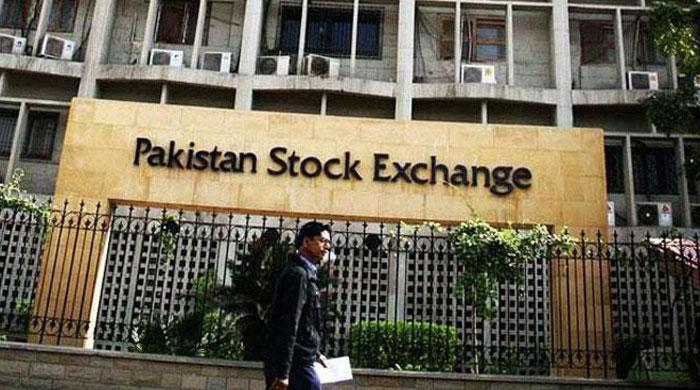 Pakistan shares close at record high
