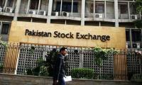 Pakistan shares close at record high