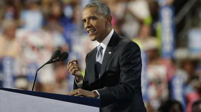 Obama passes torch to Clinton, warns election is test of US democracy