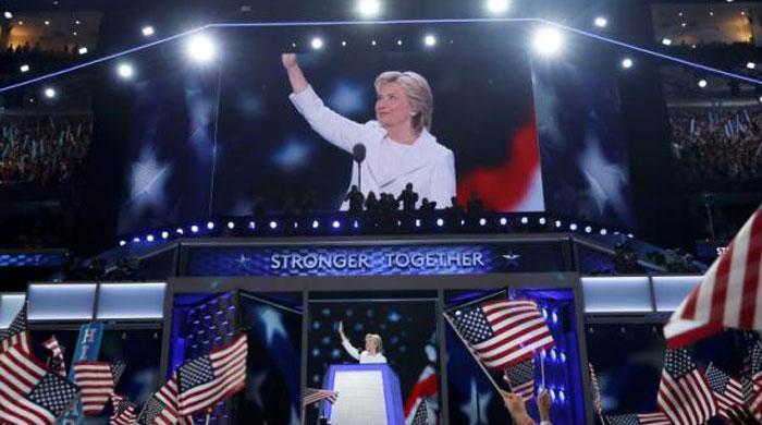 Accepting the nomination, Clinton casts herself as clear-eyed leader