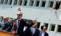 Erdogan says to close military schools, rein in armed forces