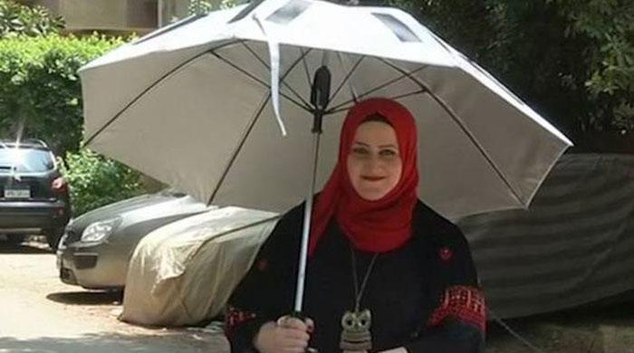 Solar-powered umbrella offers pilgrims relief