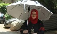 Solar-powered umbrella offers pilgrims relief