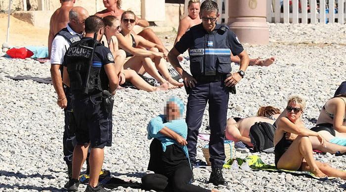 Top French court makes initial ruling to suspend burkini ban