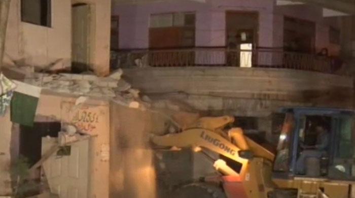 12 MQM offices razed, over 200 sealed in Karachi