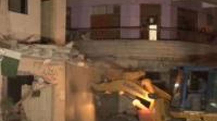 Two more MQM offices razed in Karachi, overall count reaches 32