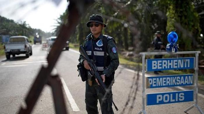 Three arrested in Malaysia over planned attacks on eve of independence day
