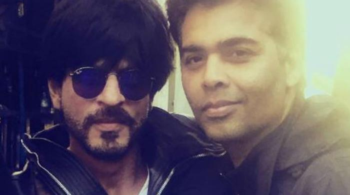 Karan Johar cannot take it anymore - Flies off to spend time with SRK