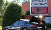 Three injured in US school shooting, suspect in custody: police