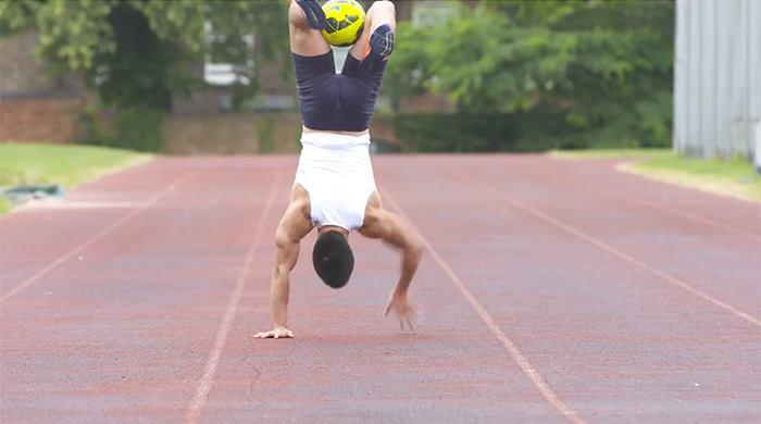 Fastest 50 metres walking on hands with a football between the legs