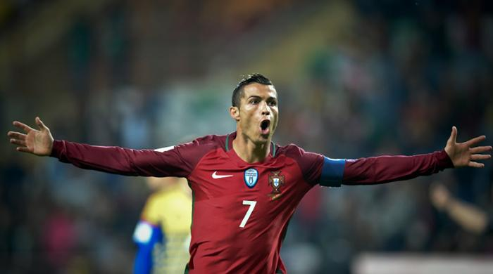 Ruthless Ronaldo hits four for Portugal, while France and Dutch run riot in World Cup qualifiers