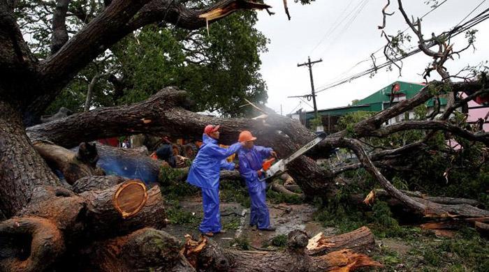 Over 90,000 people flee as Typhoon Haima slams northern Philippines