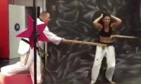 A tough karate girl breaks a stick using only her abs