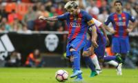 Late Messi penalty seals dramatic Barca win