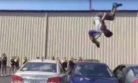 Watch as two guys trampoline over three parked cars