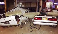 Two cars hit by falling roof debris in Karachi