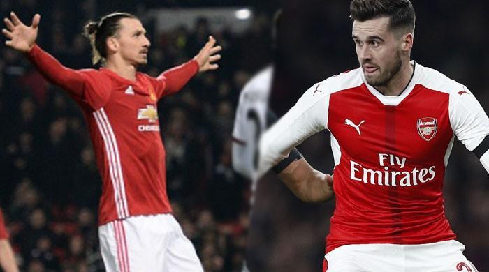 Ibra, Martial see Man Utd through, Arsenal crash