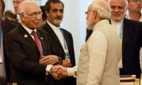 Aziz, Modi exchange pleasantries at Amritsar banquet