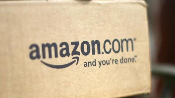 Amazon opens line-free grocery store in challenge to supermarkets
