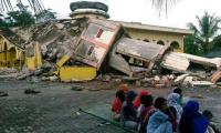 Rescuers scrabble for survivors as Indonesia quake kills 97
