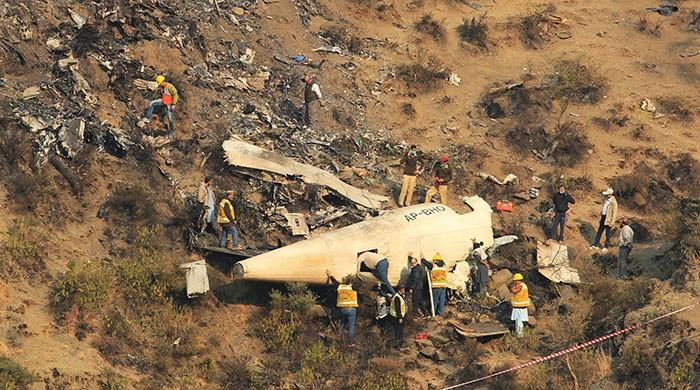 Investigation team collects samples from PIA crash site