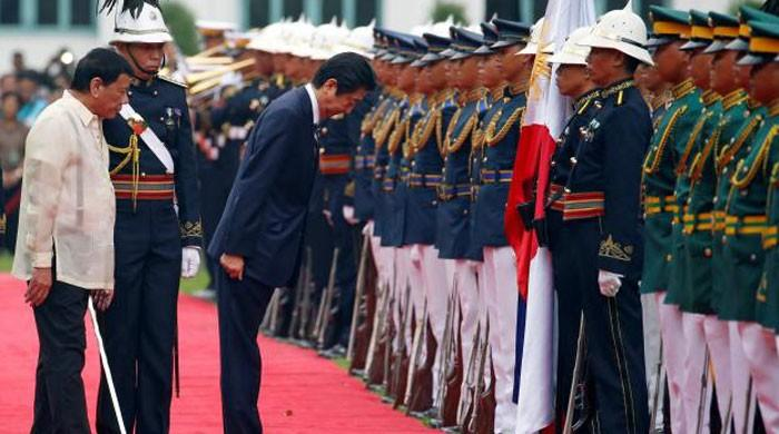 Japan PM Abe visits Philippines as Duterte's first top guest