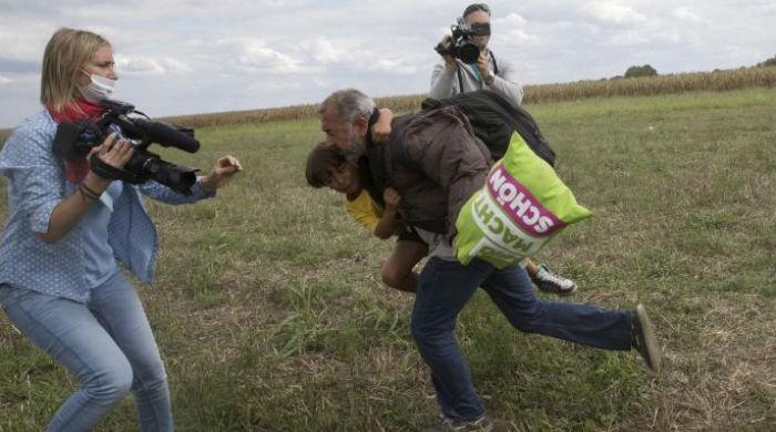 Hungarian camerawoman who kicked, tripped migrants gets probation