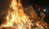 Horses leap through fire in this Spanish tradition