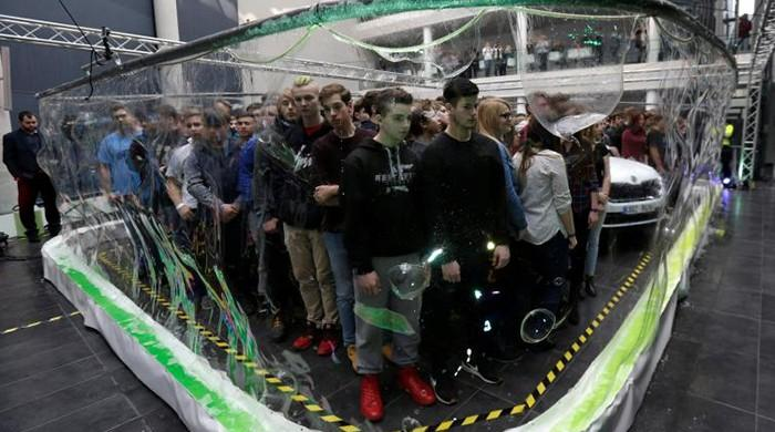 Czech bubble artist surrounds 275 students with soap screen to claim record