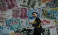 Dollar down as Trump takes over, most Asia markets up