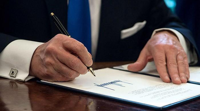 By the stroke of a pen, Trump to ban thousands from entering America